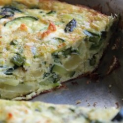 Spring Vegetable Frittata for Mother Recipe - Perfect for a Mother's Day brunch, this frittata showcases fresh spring veggies, potatoes, and cheese. Cook the potatoes before you start.