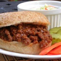 Sloppy Joe Sandwiches Recipe - This sloppy joe recipe is quick and inexpensive. In addition to putting it on rolls, try this slightly sweet beef mixture over rice, biscuits, or baked potatoes.