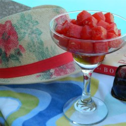 Boozy Watermelon Recipe - Watermelon soaked in cachaca, a Brazilian spirit made from sugar cane, is an intoxicating snack perfect for pool-side lounging.