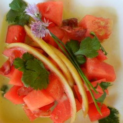 Malaysian Watermelon Salad Recipe - You've never had watermelon like this before! An Asian-inspired watermelon and bacon salad is served with home-pickled watermelon rind, cilantro, and green onions in a gingery lime dressing.
