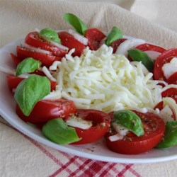 Tomato-Basil Salad Recipe - Tomato-basil salad with mozzarella cheese is topped with a light vinaigrette in this quick and easy Italian-inspired salad.