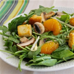 Oriental Spinach Salad Recipe - Fresh spinach is tossed with crunchy bean sprouts, sweet clementines and fresh mushrooms and topped with a soy/garlic dressing.