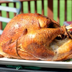 Easy Smoked Turkey Recipe - Delectable juicy smoked turkey is easy to make in an outdoor kettle grill, if you know how. The turkey cooks itself while you relax and refresh your drink.