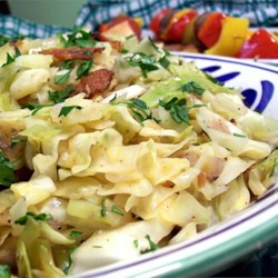 Fried Cabbage with Bacon, Onion, and Garlic Recipe and Video - This is a side dish where the title says it all. Cabbage is fried with bacon, onion, and garlic for a side dish you'll want to eat again and again.