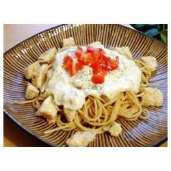Fettuccini Alfredo VI Recipe - Neufchatel cheese and Parmesan melted into a simple white sauce of margarine, garlic and flour, is tossed with hot fettuccine and sprinkled with parsley to make a lovely dish for two.