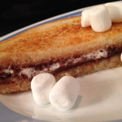 Grilled Marshmallow Nutella(R) Recipe - An irresistible treat, this grilled sandwich recipe combines marshmallows, Nutella(R), and toasted buttered bread to make a new taste sensation.