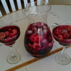 Sangria Cocktail Recipe - Sangria is a Spanish wine punch that includes chopped fruit and sparkling water for a refreshing summertime cooler.