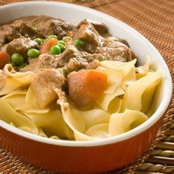Oven Beef Stew Recipe - Potatoes, carrots, and condensed onion and mushroom soups cook along with the meat for 4 to 5 hours. Green peas are added in the last 15 minutes.