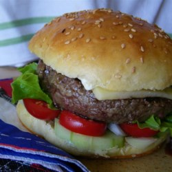 Garlic and Onion Burgers Recipe - A few hours before grilling, ground beef is mixed with Worcestershire, garlic, onion and Italian seasoning, and then the mixture is chilled until ready to form into patties for the grill. Makes six, moist and flavorful burgers.