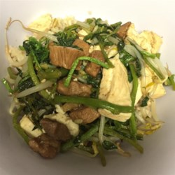 Pork Tofu with Watercress and Bean Sprouts Recipe - Asian flavors such as ginger and soy sauce season this zesty dish made with pork, watercress, bean sprouts, and tofu. Red chile garlic paste can be substituted for the ground black pepper to give even more of a kick.
