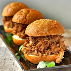 Slow Cooker Root Beer Pulled Pork Recipe - Root beer, liquid smoke, and garlic are all that's needed for simmering pork shoulder, pork butt, or loin in this easy, savory recipe.