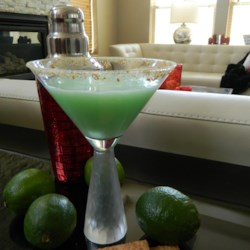 Key Lime Pie Martini Recipe - Vanilla-flavored vodka and triple sec mix with pineapple juice, sweetened lime juice, and a bit of cream to deliver a martini that tastes like Key lime pie.