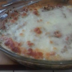 Spinach, Sausage and Cheese Bake Recipe - A mixture of Italian sausage and tomato sauce is placed on a bed of spinach and baked with three kinds of cheese in this quick and easy dinner.