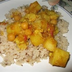 Alicia's Aloo Gobi Recipe - Here's a variation of Aloo Gobi, a traditionally dry Indian dish consisting of potatoes and cauliflower. This recipe calls for coconut milk, tomatoes and chickpeas for a savory main dish in a spicy sauce. Serve with basmati rice or, better, with breads such as roti, naan, or pita.