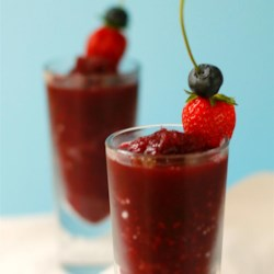Berrylicious Frozen Sangria Slush Recipe - Red wine, blueberries, raspberries, and strawberries and blended together creating a berrylicious sangria slush perfect for summer drinking.