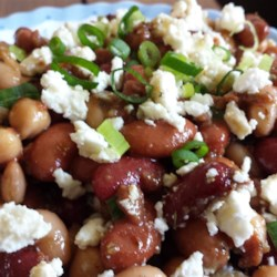 Three Bean Salad with Feta Cheese Recipe - Feta cheese and Greek seasoning give this three-bean salad recipe a flavorful twist that will be the crowd-pleaser at your next party.