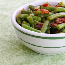 Sweet and Sour Green Beans Recipe - These quick and easy, sweet and sour green beans receive a smoky flavor from bacon and liquid smoke for an easy and crowd-pleasing side dish.