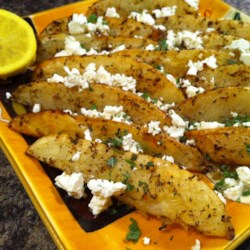 Baked Greek Fries Recipe - Greek-seasoned potato wedges with feta and mint pair well with barbecued meats.