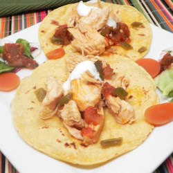 Basic Chipotle Chicken Tacos Recipe - Chicken is marinated with chipotle peppers in adobo sauce and dark beer in this basic recipe for chipotle chicken tacos.
