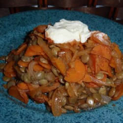 Carrots and Lentils Recipe - Carrots and lentils simmered in a tomato broth create a Turkish-inspired dish that vegetarians and meat-eaters will equally enjoy; serve with a dollop of Greek yogurt.