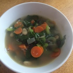 My Trainer's Kale Soup Recipe - Kale soup loaded with beans and vegetables is a hearty and flavorful soup to have for lunch or dinner. Serve with a chunk of crusty bread.