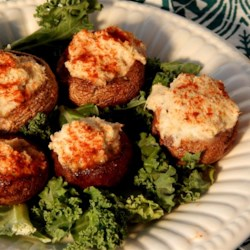 Crab Stuffed Mushrooms III Recipe - These are a favorite in our family. Mushroom caps are stuffed with a rich crabmeat filling and baked.