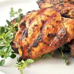 Grilled Chicken with Herbs Recipe - Fresh rosemary, thyme and sage blend with garlic, olive oil and balsamic vinegar for an herby marinade.