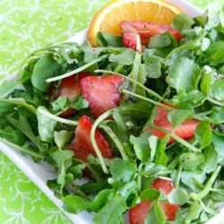 Summer Greens and Strawberries with Poppy Seed Dressing Recipe - Strawberries are tossed with arugula and watercress in an orange-accented poppy seed dressing for a lovely, simple summer salad.