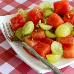 Watermelon Salad with Grapes and Citrus Recipe - Watermelon and grape salad has an extra zip thanks to lemon zest and lime zest stirred into the mix; serve on a hot summer day.