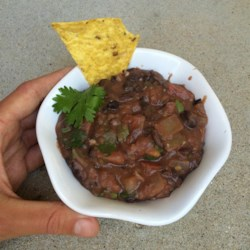 Tex Mex Black Bean Dip Recipe - Traditionally Southwestern flavors like cumin and cilantro lend a distinctive note to this creamy bean dip, while corn kernels add a little crunch. Serve warm or at room temperature.