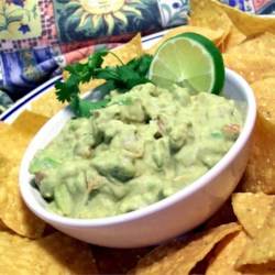 Chipotle Guacamole Recipe - This spicy guacamole recipe is very easy to customize to your own tastes. The addition of lime and chipotle puts a spin on a simple recipe to separate it from the pack.