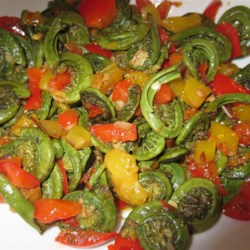 Spring Fiddleheads and Sweet Peppers Recipe - Delicious, wild-foraged fiddlehead ferns appear fresh in the spring at farmers' markets, or you can forage for them yourself in the freezer section of many groceries throughout the year.