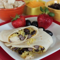 My First Easy Cheesy Mexican Roll-Up Recipe - An easy to make (calling all kids!) tortilla roll-up with black beans, diced chicken, and shredded cheese.