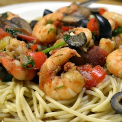 Shrimp Pasta with Tomato Basil Sauce Recipe - Mushrooms, tomatoes, and basil simmer with red wine and a splash of lemon juice to make a light sauce for shrimp and linguine.