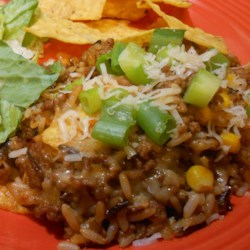 Easy One-Pan Taco Skillet Recipe - This one-pot dinner with rice, browned ground beef, taco seasoning, and corn is easy and kid friendly - served with a green salad, it makes a great weeknight meal.
