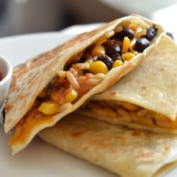 Wild Rice, Corn, and Black Bean Quesadillas Recipe - These quick and delicious quesadillas are filled with rice, corn, black beans, and cheese and served with your favorite salsa.