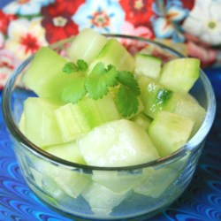 Honeydew and Cucumber Salad Recipe - Refreshing bites of cucumber and melon are marinated in a lemony dressing.