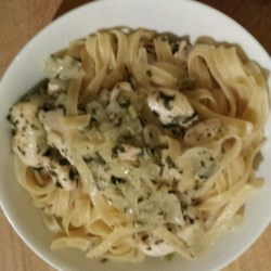 Chicken and Onions Over Linguini Recipe - This pasta dish is made with boneless, skinless chicken breasts in a sauce of onions and fresh herbs. Serve over whole wheat linguini.