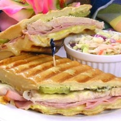 Classic Cuban Midnight (Medianoche) Sandwich Recipe - This is one of the more famous sandwiches straight out of the island of Cuba. This recipe came from my uncle who used to work at a restaurant in Pinar del Rio, Cuba and now works at a Cuban cafeteria here in Miami. This sandwich is best served with fried plantain chips and a cold mamey milkshake!