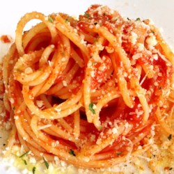 Awesome Sauce Recipe - A pork neck and tomato paste work with a few handfuls of seasoning to make this large batch of pasta sauce.