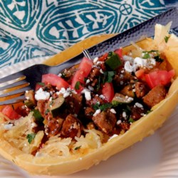Spaghetti Squash Mediterranean-Style Recipe - A hearty Mediterranean-style dish features spaghetti squash seasoned with Italian sausage and feta cheese.