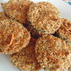 Healthy Zucchini Chips Recipe - Replace your potato chips with these homemade zucchini chips made with Parmesan cheese and garlic powder for a crispy snack.