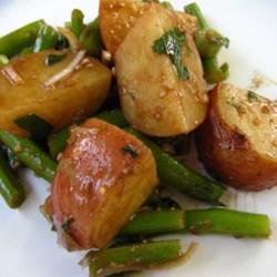 Green Bean and Potato Salad Recipe - A twist on potato salad. Green beans and potatoes are served in a Dijon mustard and balsamic vinaigrette.