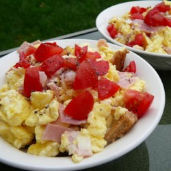 Something Interesting with Egg Recipe - Bread cubes are topped with creamy scrambled eggs, ham, tomato, and cucumber in this quick and easy breakfast that your family will love.