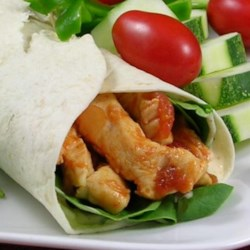 Simple Sweet and Spicy Chicken Wraps Recipe - A flour tortilla is filled with sweet, spicy chicken simmered in salsa, and rolled with a cucumber, honey, and pepper mayonnaise.