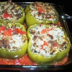 Stuffed Bell Peppers, Greek Style Recipe - Lamb, rice, and ground dried mint fill these delicious, Greek-style bell peppers.