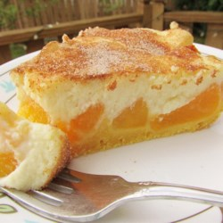 Award Winning Peaches and Cream Pie Recipe - This recipe yields a fabulous 10-inch deep-dish pie with an unusual crust made with vanilla pudding, flour, milk, butter, and a bit of baking powder. Sliced peaches are spread over the crust and topped with a fluffy cream cheese layer. It 's then baked and chilled before serving.