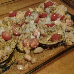Eggplant Stuffed with Chicken and Cheese Recipe - Eggplant is topped with chicken, cheese, and tomatoes in this quick and easy stuffed eggplant recipe that fits into a gluten-free lifestyle.