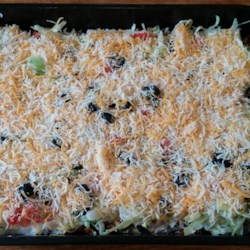 "The Best Taco Dip Recipe - This is a flavorful and spicy layered appetizer dish that you can serve with tortilla chips. It reheats wonderfully, if there's any left over! And that's a big ""if."""
