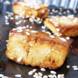 Garlic Ginger Tofu Recipe - Tofu simmered in its own juices and seasoned with garlic, fresh ginger, and a little lime juice - this pairs well with steamed rice and veggies to make an easy weeknight meal.